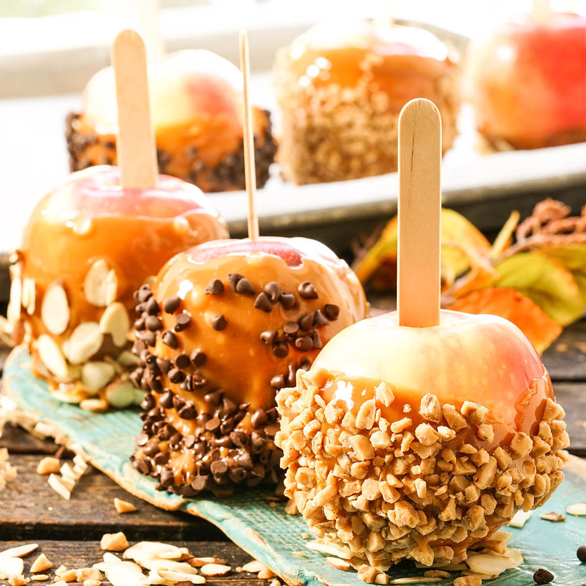 Caramel apples on plate for easy halloween party food.