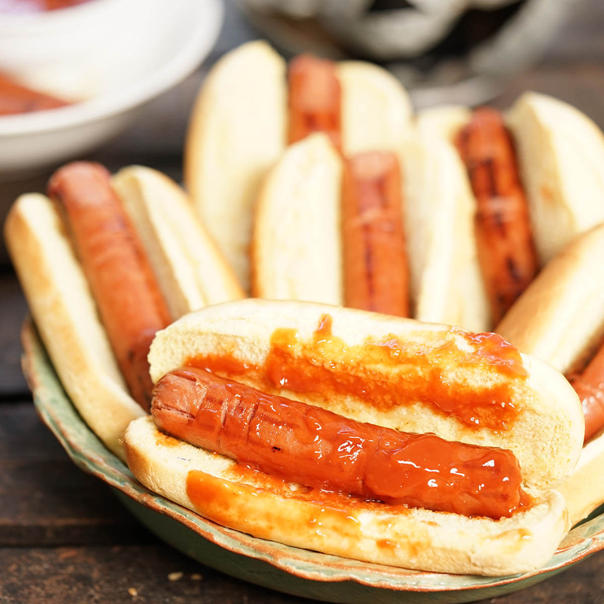 Hot dogs carved to look like finger that are in a bun topped with catsup.