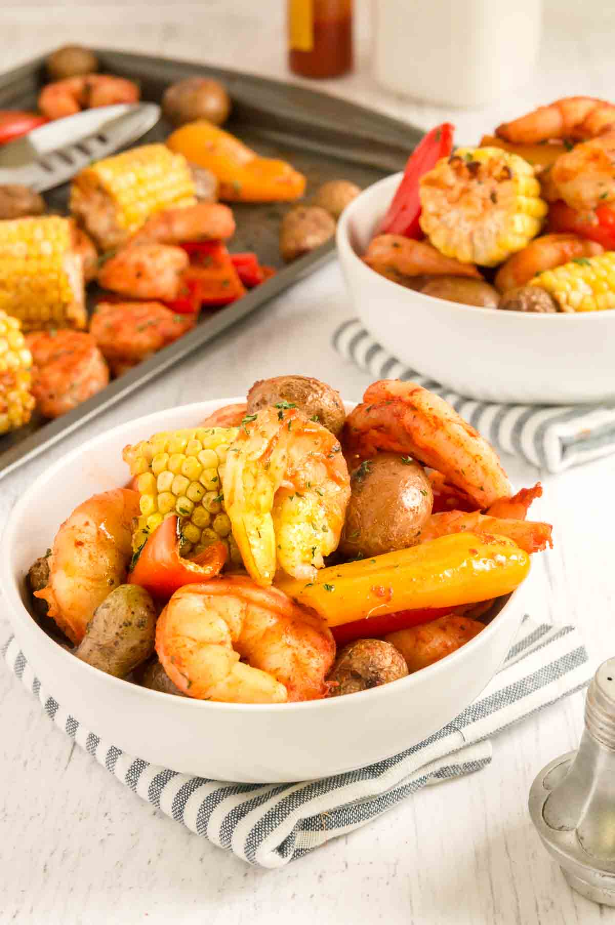Two bowls filled with Sheet Pan Shrimp Boil