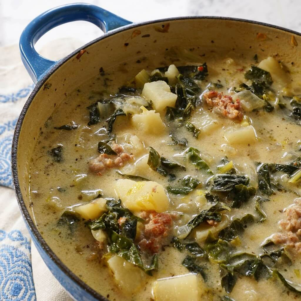 A soup pot filled with Zuppa Toscana Soup