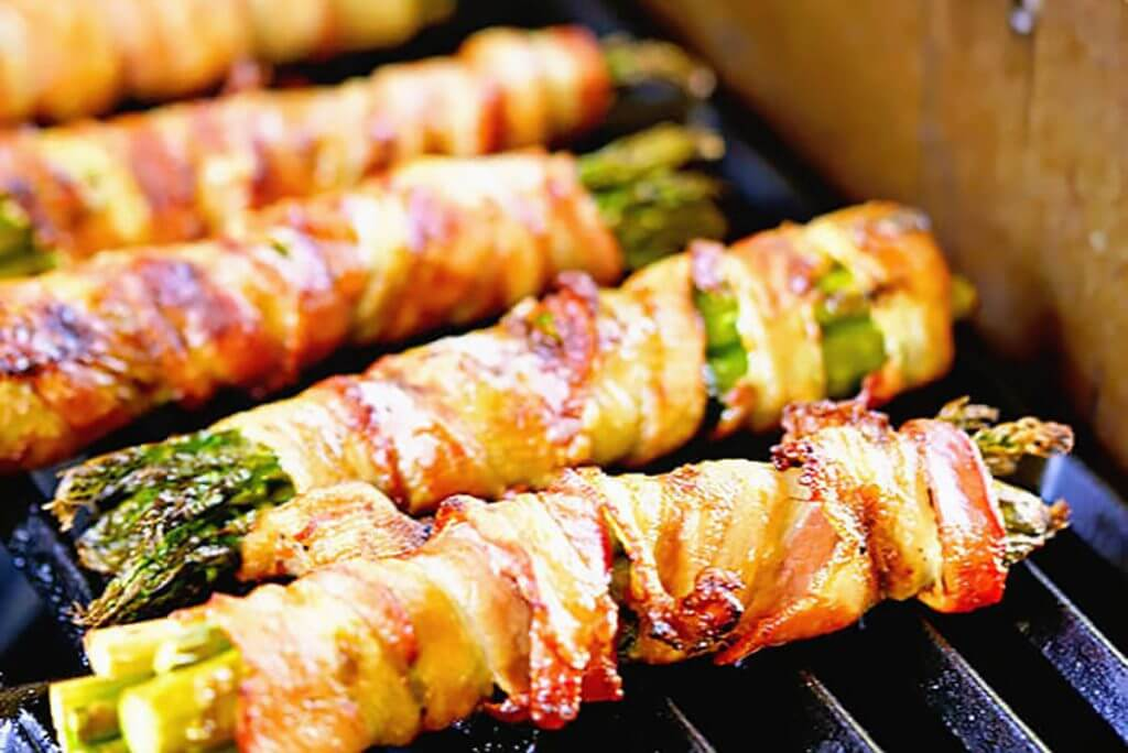Bacon Wrapped Asparagus on grill for holiday side dish