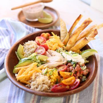 Rotisserie Chicken Burrito Bowl with salad dressing.