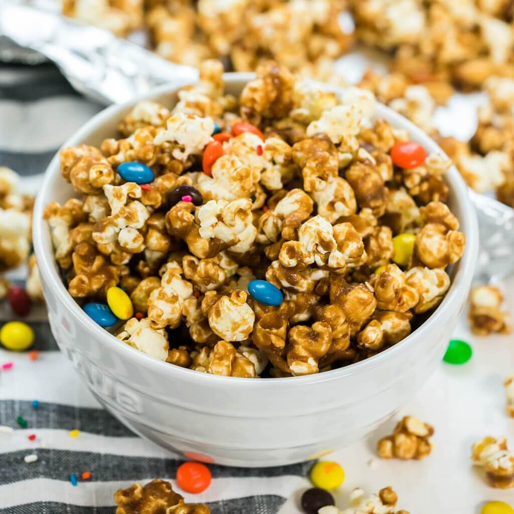 Caramel Popcorn topped with candy and sprinkles.