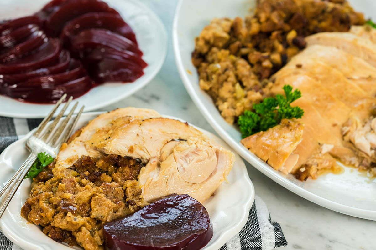 A plate filled with Crockpot Stuffed Turkey Breast.