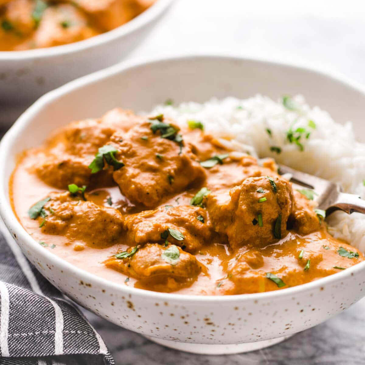 Easy Instant Pot Recipe Butter Chicken served with rice.