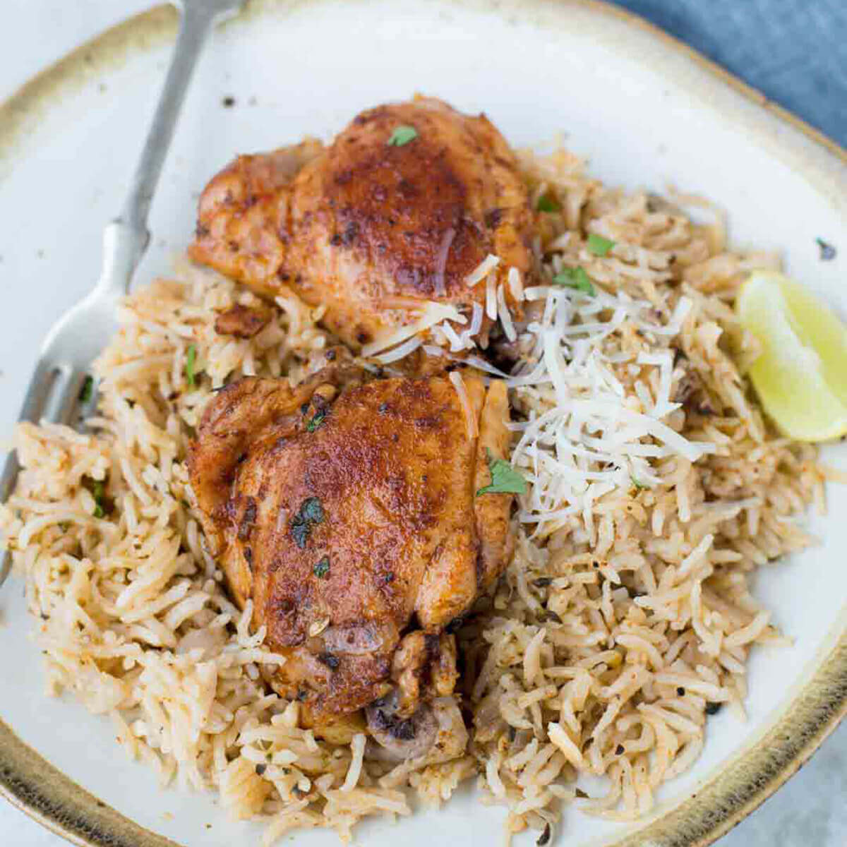Garlic Herb Chicken on place served over brown rice.