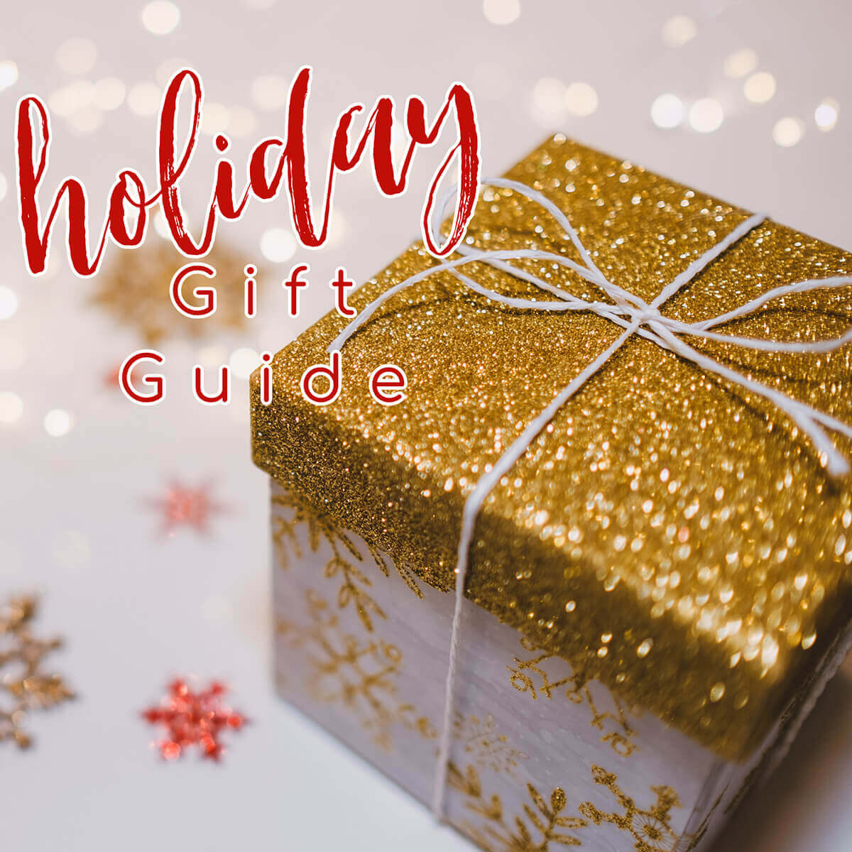 Box wrapped in holiday paper with holiday gift guide overlay.