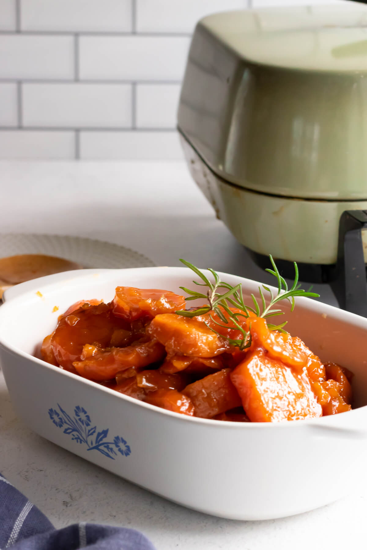 Candied yams in white bowl
