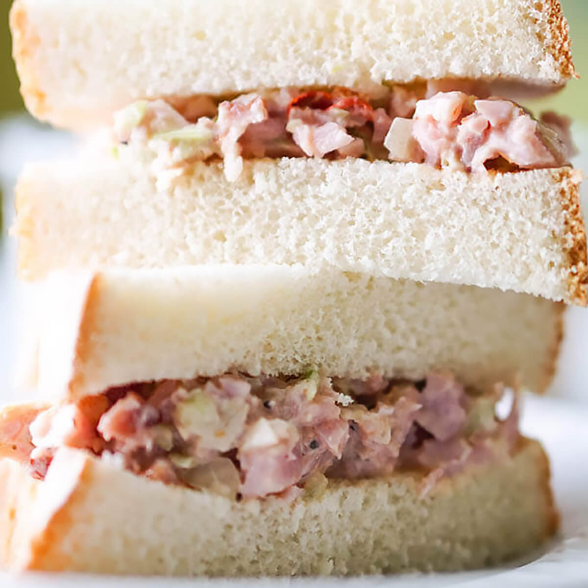 Ham sandwich with white bread.