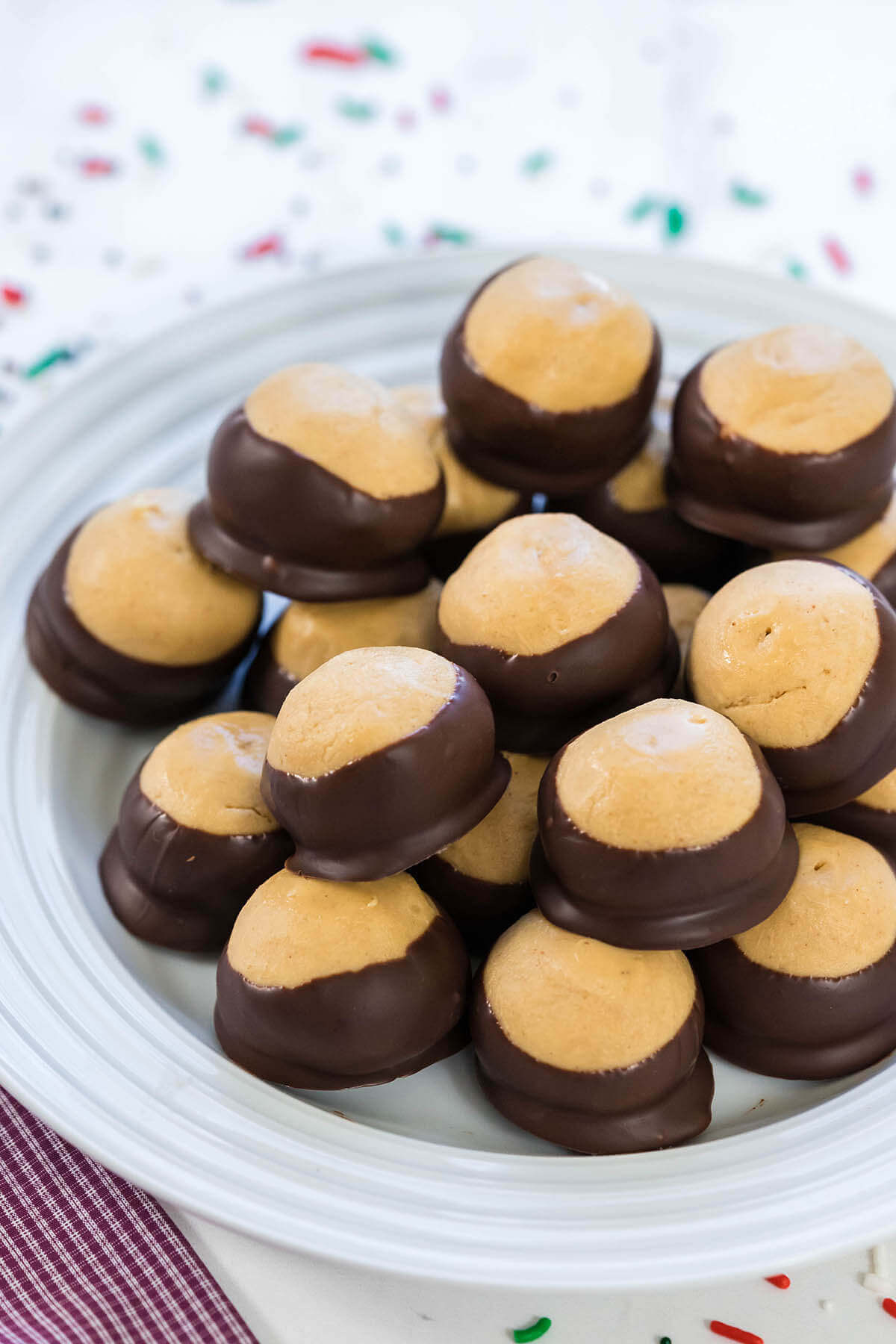 Homemade Buckeyes on a white plate.