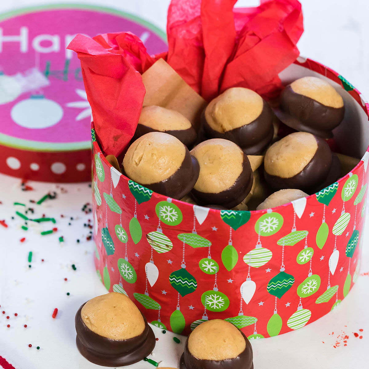 Buckeye candy in a red holiday box.