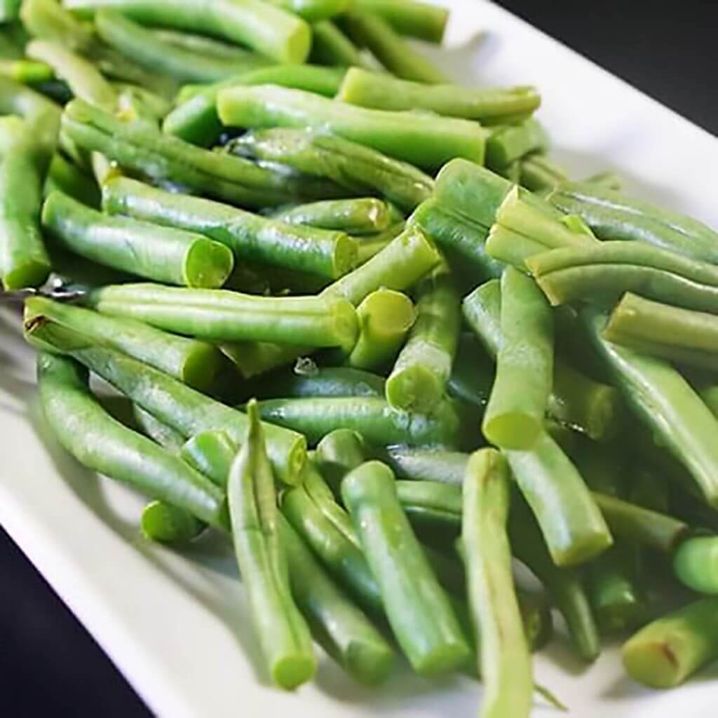 Steamed Green Beans on a white platter