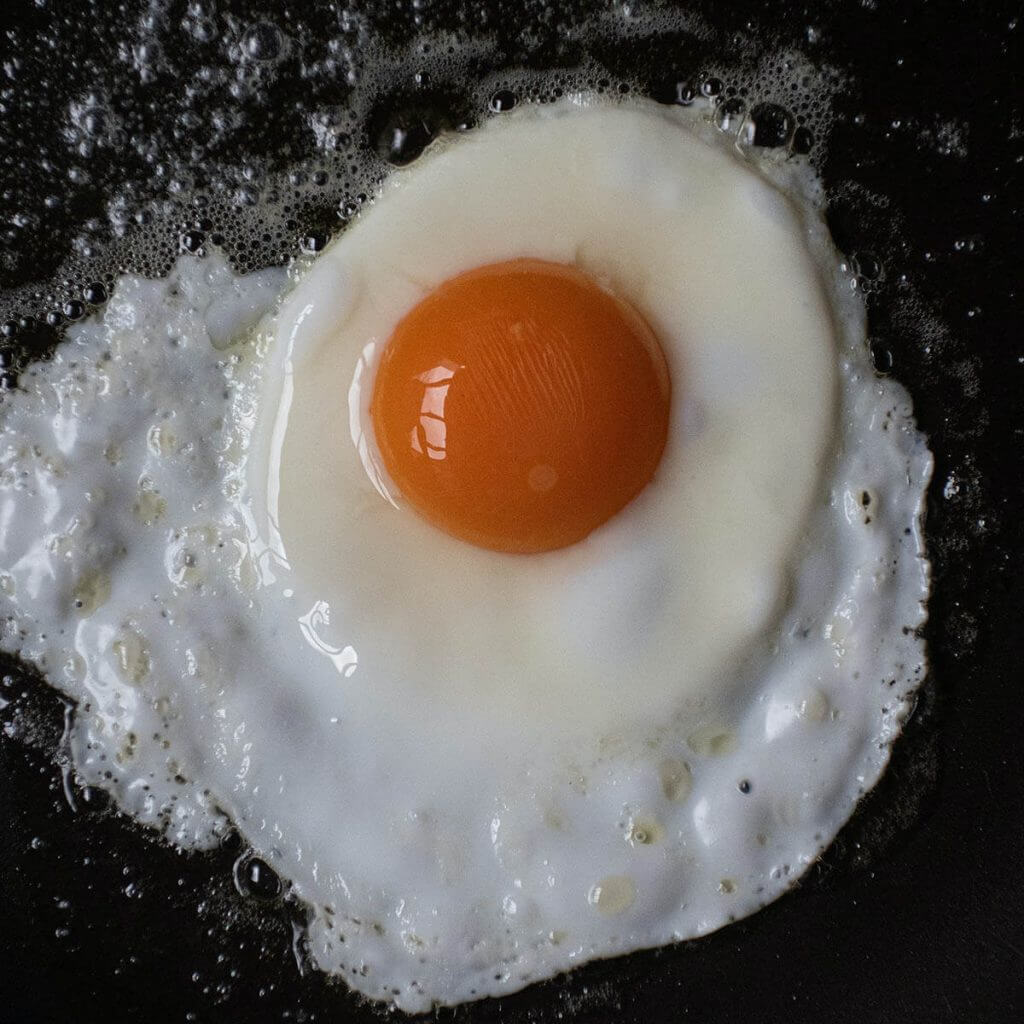 fried egg sunny side up in fry pan.