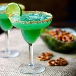 Irish Margarita Cocktail Garnished with slices of limes.