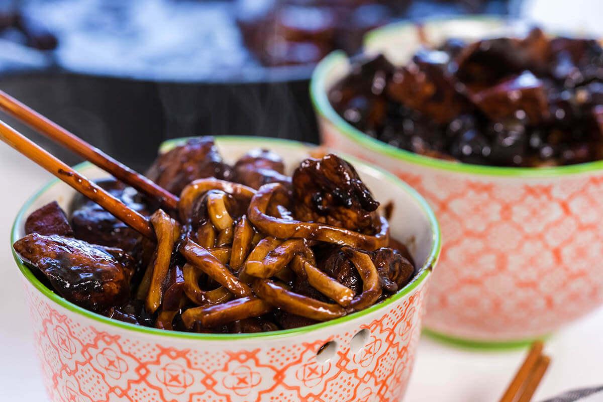 Korean Black Bean Noodles in bowls served with chopsticks.
