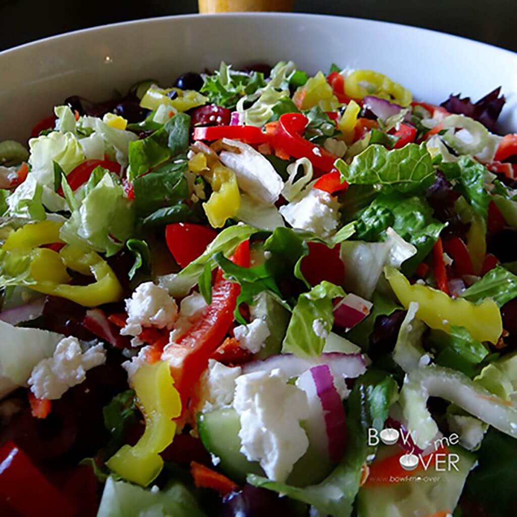 Big white bowl filled with greek salad