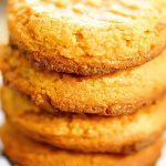 Four peanut butter cookies stacked on top of each other.