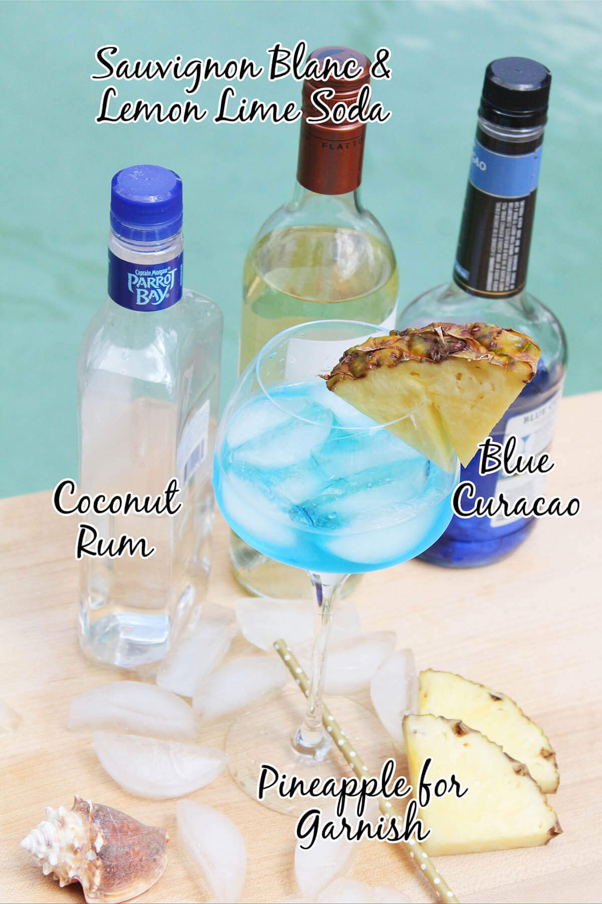 Ocean Breeze Cocktail with bottles of rum, wine & blue curaçao. With print overlay.