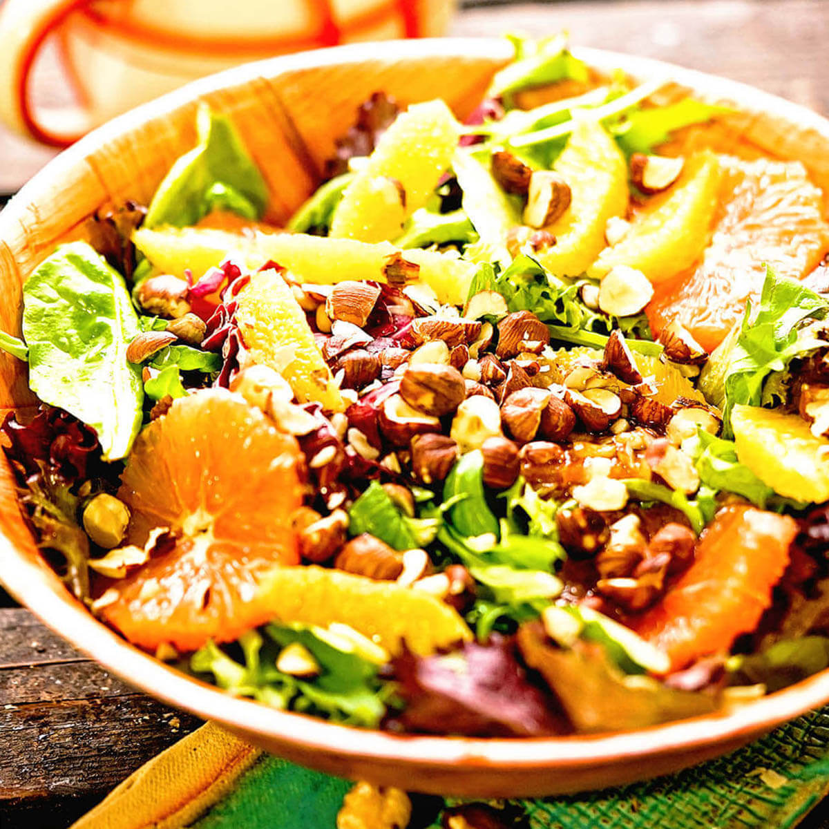 Citrus Green Salad topped with nuts.