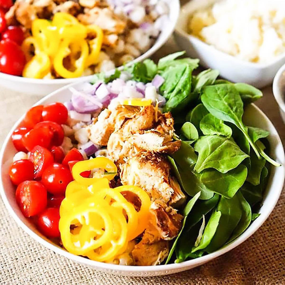 Colorful chicken burrito bowls.