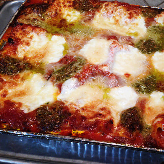 Homemade lasagna in casserole dish.
