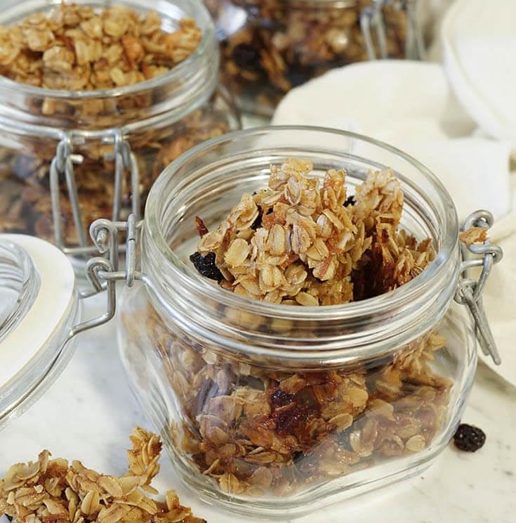 Homemade granola stored in glass jars.