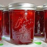 Jars of sealed strawberry preserves