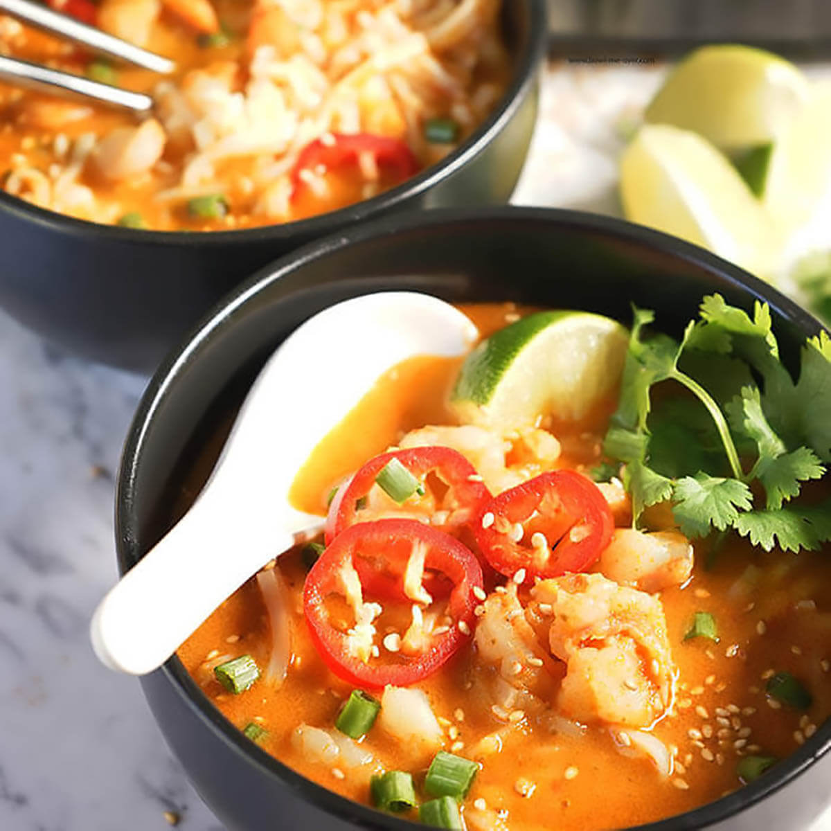 Bowls of Thai Noodle Soup with spoon.