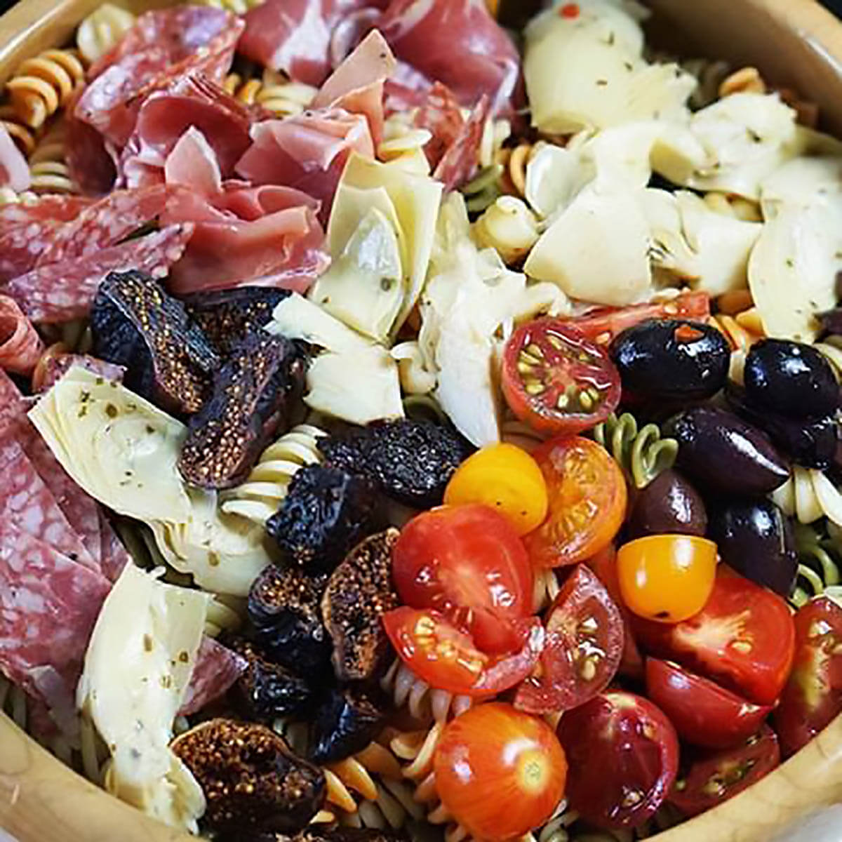 Anitpasto Pasta salad with salamini, artichokes, cheese, olives and tomatoes.