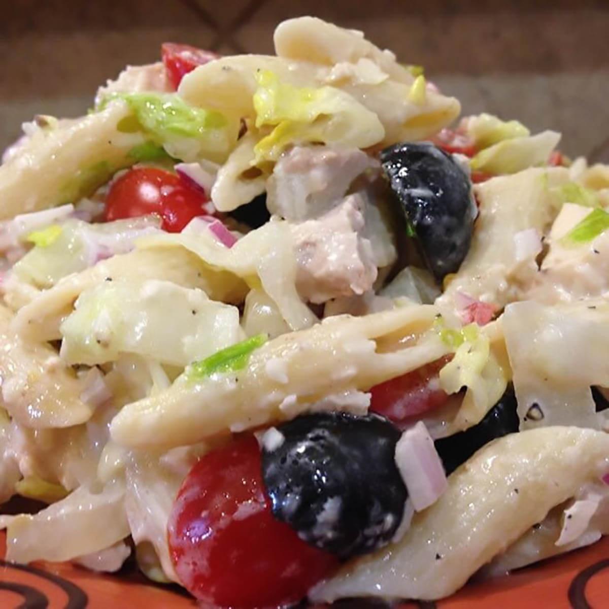 Chicken Caesar pasta salad on platter.