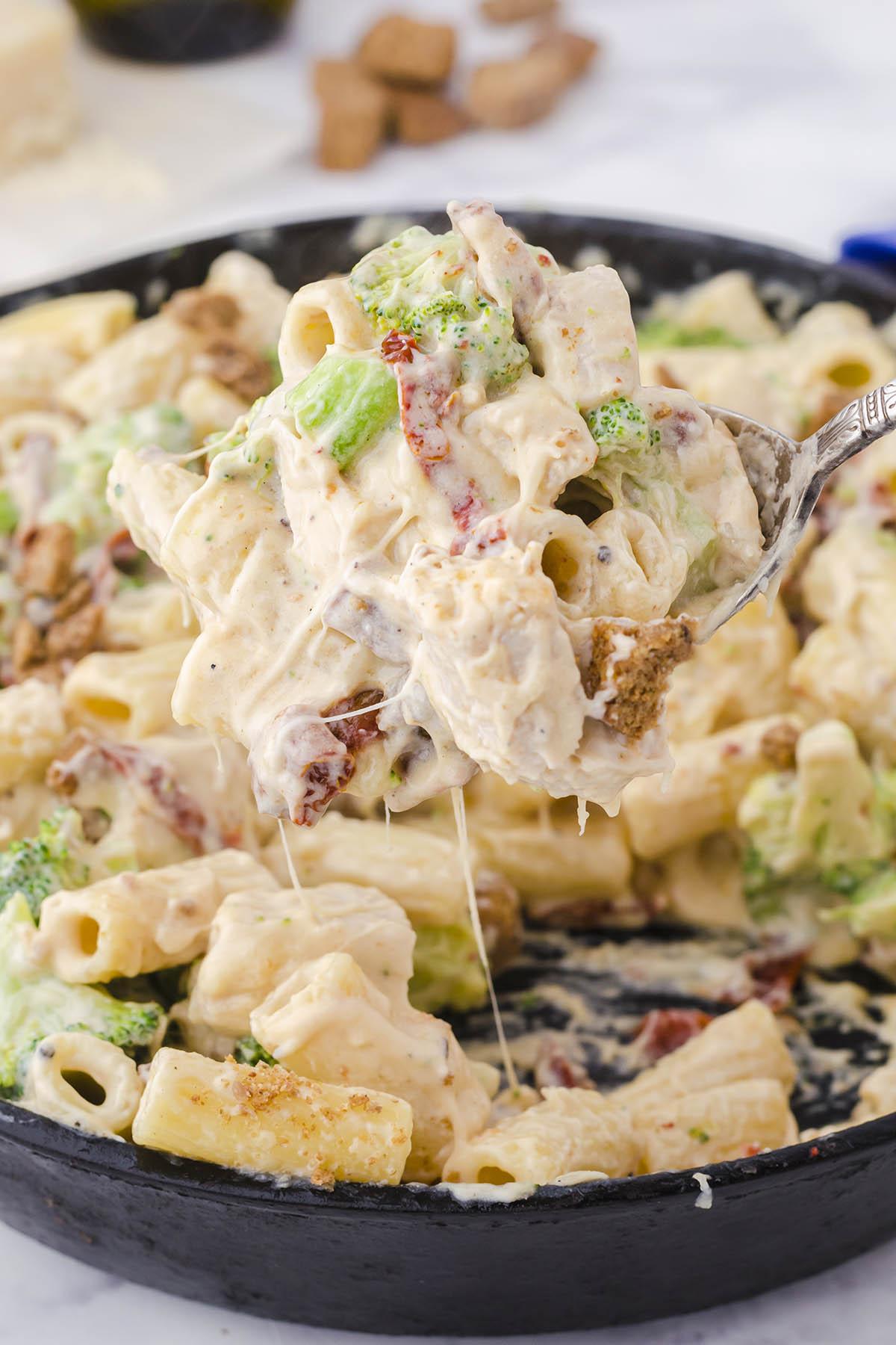 Alfredo Chicken and pasta in cast iron skillet.