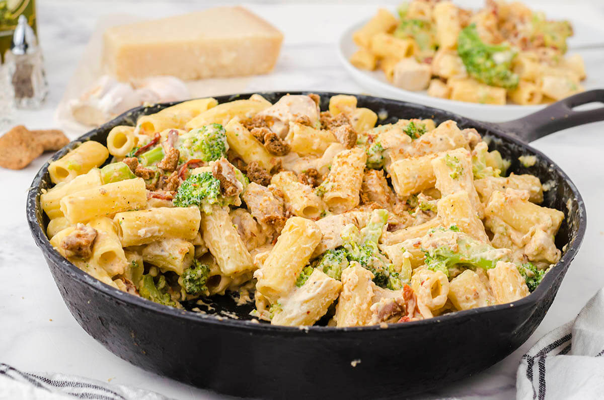 Copycat Cheesecake Factory Chicken and Broccoli Pasta in cast iron skillet.