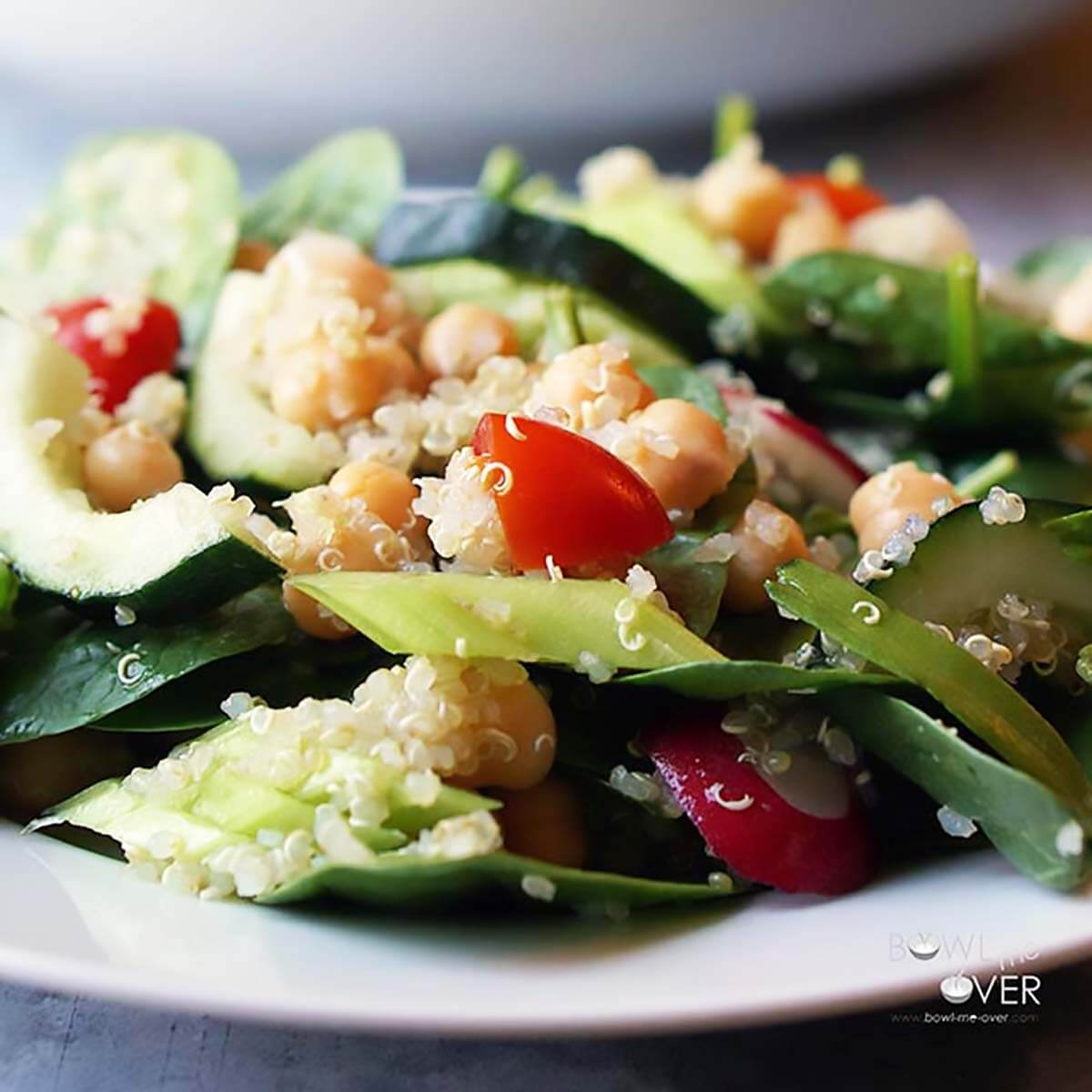 Spinach Salad on white plate.
