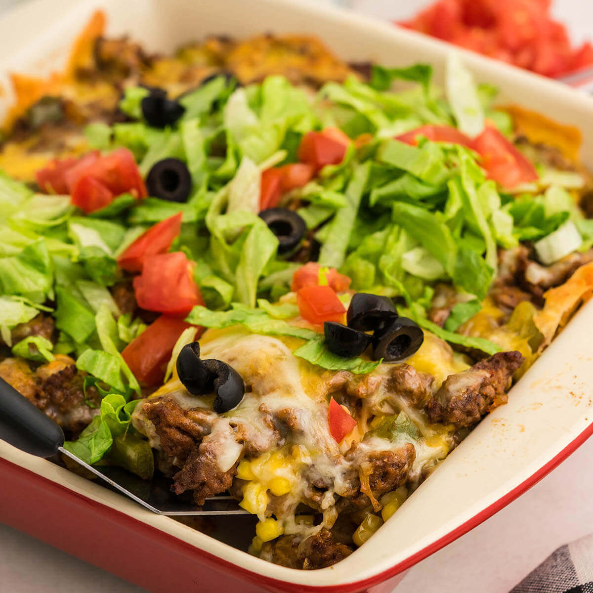 Dish filled with Taco Salad Casserole.