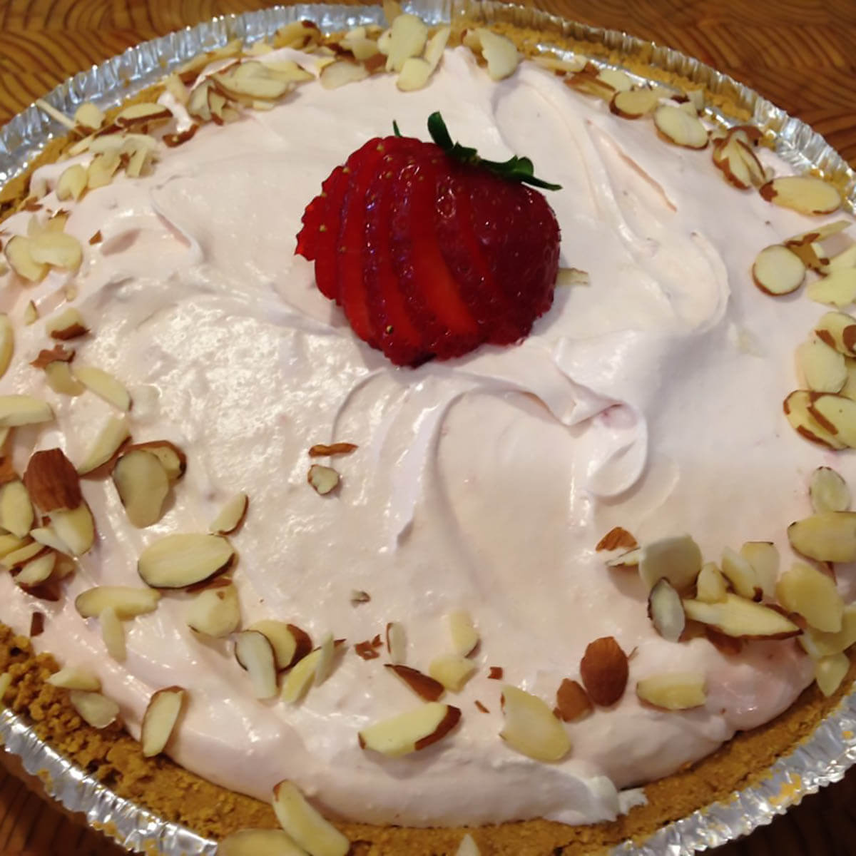 No bake strawberry Pie topped with almonds and sliced strawberries.