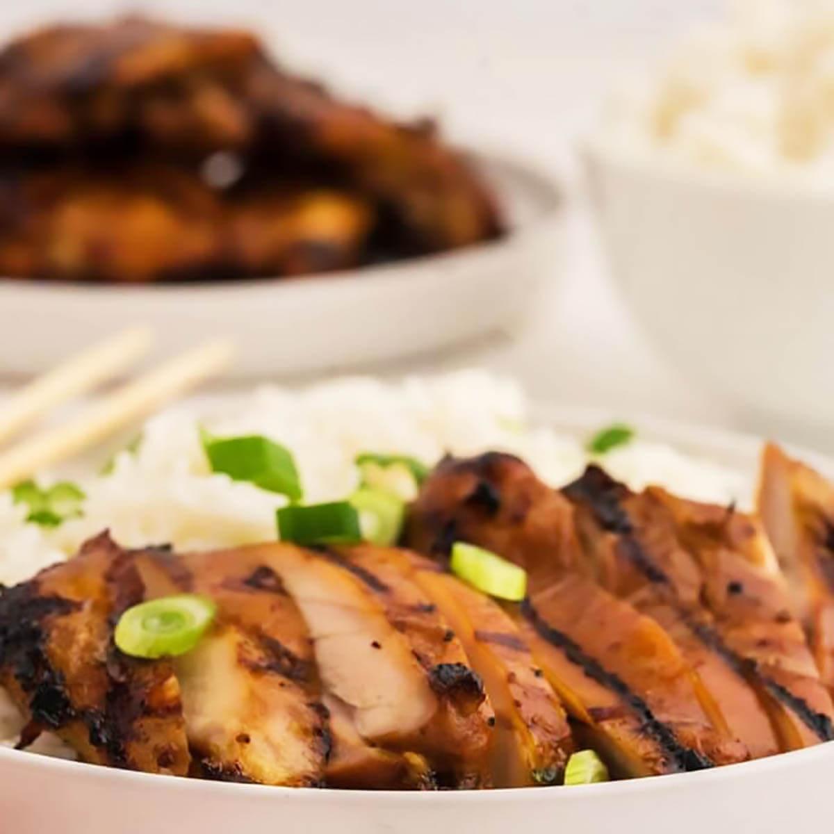 Sliced teriyaki chicken served with rice.